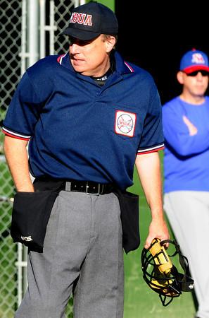 Rowley: Umpire Rob Prunier. Bryan Eaton/Staff Photo