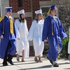 Georgetown: Georgetown High seniors walk on to the field as graduation excersises commence on Saturday. Bryan Eaton/Staff Photo