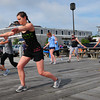 Newburyport: Participants of Fuel Training Studio workout on Newburyport's waterfront near the Black Cow restaurant. Bryan Eaton/Staff Photo