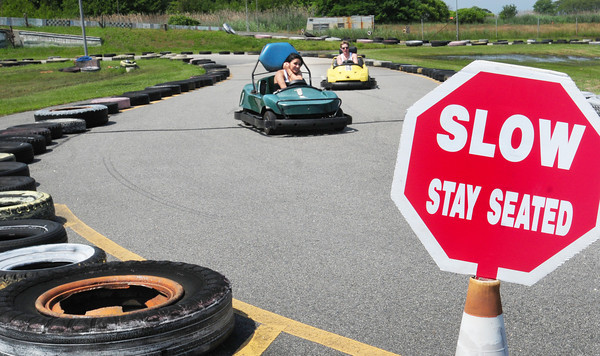 Salisbury: Victoria Howell, left, of Boxford and Mike Bailey of Groveland spin around the track at Kartland at Salisbury Beach. Bryan Eaton/Staff Photo