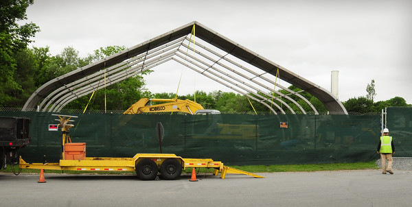 Newburyport: The huge tent covering the cleanup site at the old gassification plant on Water Street is being dismantled. Bryan Eaton/Staff Photo