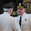 Merrimac: New Merrimac Police Chief Eric Shears, right, is congratulated by outgoing chief James Flynn after being sworn in yesterday. Bryan Eaton/Staff Photo