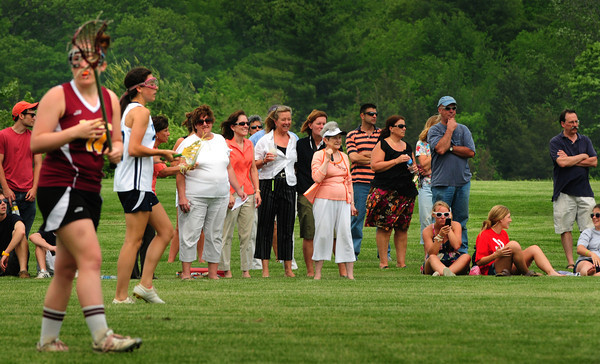 Byfield: A large group of spectators gathered in Byfield to watch Triton host Newburyport in girls lacrosse for tournament play. Bryan Eaton/Staff Photo