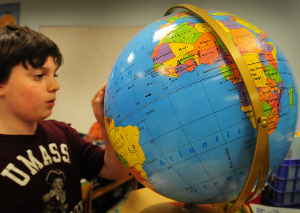 Amesbury: Andrew Courtemanche, 9, looks for Philadelphia, where the Continental Congress was based, on a globe in Karen Iworski's third grade class at the Cashman School in Amesbury on Thursday. The students were learning about Massachusetts and it's place in Colonial history and recently took a Liberty Tour to Concord and Lexington. Bryan Eaton/Staff Photo