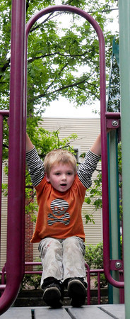 Newburyport: Liam Londergan, 5, of Newburyport plays on the equipment at the Inn Street Tot Lot on Tuesday afternoon. Due to the cooler weather, he had the playground to himself. Bryan Eaton/Staff Photo