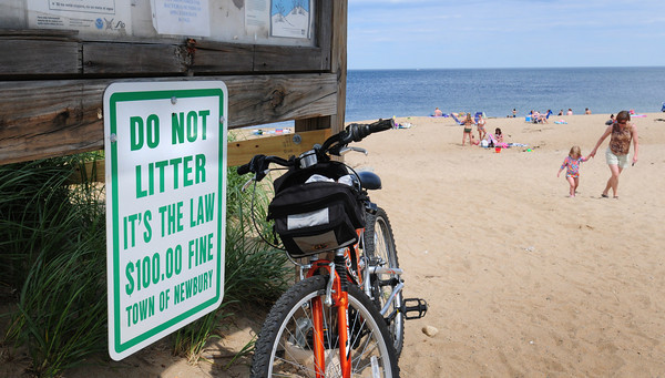 "Newbury: The Plum Island Foundation is hoping to put trash receptacles at certains spots on the island as there are no trash barrels due to cutbacks in Newbury's budget. This sign at the center encourages ""carry in, carry out."" Bryan Eaton/Staff Photo"