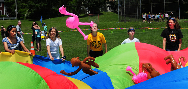 Newburyport: Molin Upper Elementary students play Jungle Gone Wild using a parachute to pop blowup animals off as they shake it. They were at their year end Field Day yesterday afternoon, though school isn't out until next week. Bryan Eaton/Staff Photo