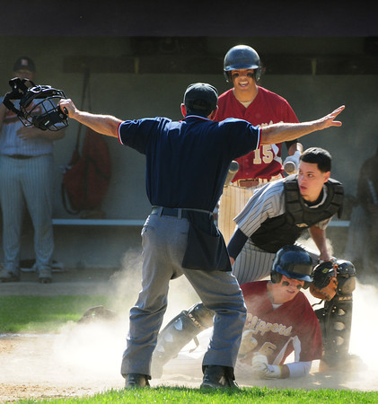 Newburyport: Newburyport's Brett Fontaine is ruled safe at home on a hit by Jimmy Conway. Bryan Eaton/Staff Photo