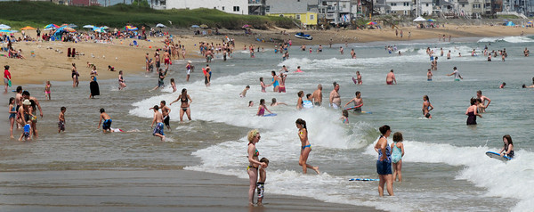Salisbury: Swimmers and sunbathers hit Salisbury Beach State Reservation for yesterday's warm and humid weather. Larger crowds are expected to beaches this holiday weekend as nice weather continues with several fireworks displays throughout the area including Salisbury Beach. Bryan Eaton/Staff Photo