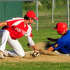Rowley: North Andover's Cam Coulliard makes the run past Post 150 third baseman Brett Fontaine. Bryan Eaton/Staff Photo