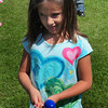 Amesbury: Kristina Wright, 8, tries her best to not drop the plastic egg in the Egg and Spoon Race yesterday morning. She was at Field Day at the Cashman School in Amesbury. Bryan Eaton/Staff Photo