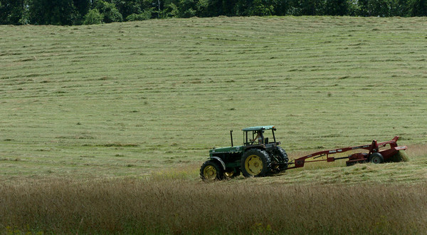 Amesbury: The hay gets mowed at Woodsom Farm in Amesbury yesterday in preparation for the crowd to gather to watch the fireworks on Monday for Amesbury Days. Bryan Eaton/Staff Photo