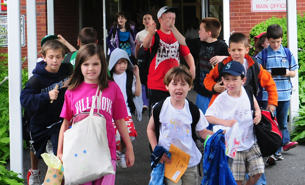 Amesbury: Amesbury Elementary Schools bolt out of school yesterday at 3:00 p.m., the last of the local school districts to break for summer vacation. Bryan Eaton/Staff Photo