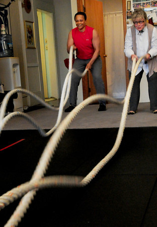 Newburyport: Eunice James, left, demonstrates undulating ropes to Vicki Hendrickson at her Newburyport studio. James is offering a summer camp for adults looking to learn something new and experience a little bit of fun. Bryan Eaton/Staff Photo