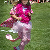 Newburyport: Mikayla Vincent, 10, competes in Pretty In Pink at the Molin Upper Elementary School's Field Day yesterday afternoon. Children threw on crazy pink overclothes, ran a lap, took the clothes off for the next person in the timed relay. Bryan Eaton/Staff Photo