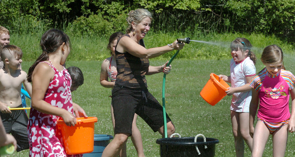 """Amesbury: Amesbury Elementary School teacher Suzanne Morin has as much fun as her students as they held an end of year """"Water Day"""" on Tuesday. Bryan Eaton/Staff Photo"""