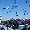 Byfield: Triton graduates toss their caps into the air at the end of graduation Saturday in Byfield. Bryan Eaton/Staff Photo
