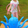 Seabrook: Mckenzie Perkins, 8, tries her luck at the Octopus Ring Toss at Seabrook Elementary School on Tuesday morning. She was in the school's Reading Carnival celebrating the books students have read at home. Bryan Eaton/Staff Photo