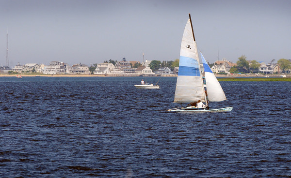 Newburyport: It's been a good week for being out on the water as is this catamaran over Joppa in the Merrimack River as temperatures have been very warm. Rain is likely Thursday night, but temperatures drop to a more comfortable zone. Bryan Eaton/Staff Photo