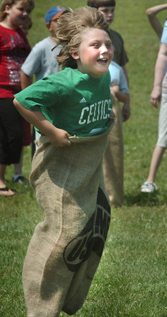 Seabrook: Cole Woodman, 9, hops along in the sack race at Seabrook Elementary School on Wednesday morning. He was participating in the school's annual Field Day filled with various activities and followed by a cookout. Bryan Eaton/Staff Photo