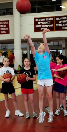 Newburyport: Madison McGrath, 11, of Amesbury shoots at Clipper Girls Basketball Camp at Newburyport High yesterday. Bryan Eaton/Staff Photo