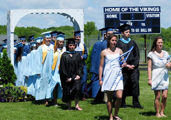 Byfield: Triton High seniors walk onto the football field Saturday at the beginning of graduation excersises, Bryan Eaton/Staff Photo