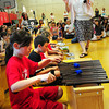 Amesbury: Cashman School music teacher Mary Krikorian directs students playing the xylophones in the gymnasium Tuesday morning. The children were in a year end all-school music assembly.