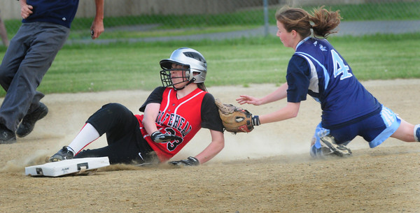 Byfield: Triton shortshop Brooke Jamison is late with the tag on Marblehead's Alexa Gross as she steals second base. Bryan Eaton/Staff Photo