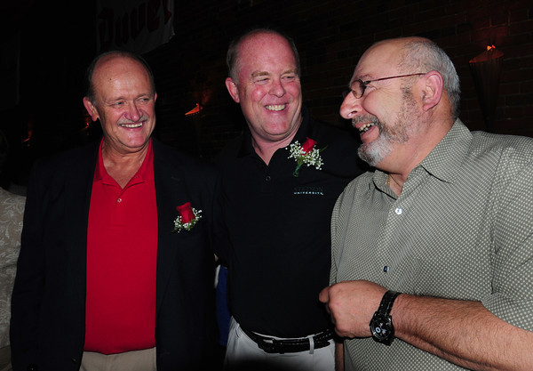 Amesbury: Retiring Amesbury Schools Superintendent G. David Jack, left, and retiring Amesbury High School Principal Les Murray, get ribbed by Charles LaBella, right, at a retirement party at the Ale House on Monday night. Bryan Eaton/Staff Photo