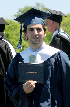 Byfield: Nicholas Martin shows off his diploma to the crowd. Bryan Eaton/Staff Photo