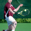 Byfield: Newburyport singles player Dan Orencole returns a shot against St Mary's at their match at The Governors Academy Friday. Jim Vaiknoras/Staff photo