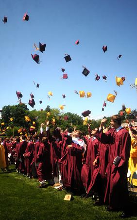 newburyport: Newburyport high graduates toss their caps at Sunday's Graduation Ceremonies at War Memorial Stadium. Jim Vaiknoras/Staff photo