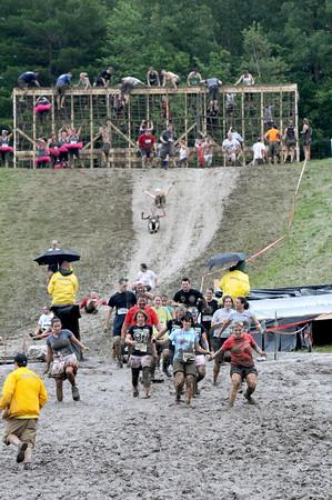 Amesbury: Runners make their way down the muddy hill during Saturday's Worrior Dash at Amesbury Sports Park . Jim Vaiknoras/Staff photo