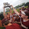 lowell: The Newburyport's Ryan O'Connor hold up the championship trophy after the Clippers 3-1 victory over St Mary's  in the Division 3 North Sectional Championship game at LeLacheur Park in Lowell Saturday. Jim Vaiknoras/Staff photo