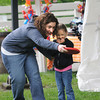 Danvers: Gianna Ferraro, 4, gets some help from her aunt Lisa Ferraro while trying out the Fun Games run by the Danvers Recreation Department at the Danvers Family Festival at Endicott Park Saturday. JIm Vaiknoras/Staff photo