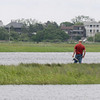 Newbury: A man fishes out of the marsh in the Plum Island River this weekend. Jim Vaiknoras/Staff photo