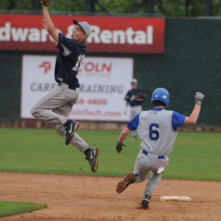 Lowell: Georgetown's Mark Berland steals second in the rain at the  Div 4 North Sectional Championship , the Royals defeated Trinity 9-2 at LeLacher Park in Lowell.Jim Vaiknoras/Staff photo