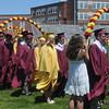 newburyport: The Newburyport high graduation procession enters World War Memorial Stadium under the Junior Arch of Roses at Sunday's Ceremonies. Jim Vaiknoras/Staff photo