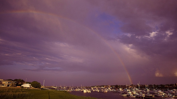 Salisbury: A rainbow caused by a an evening shower spans the Merrimack River from Newburyport to Salisbury. Jim Vaiknoras/Staff photo
