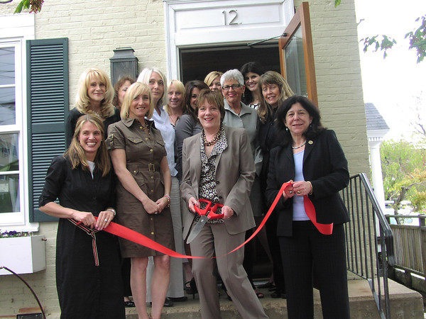 William Raveis Dolores Person Group recently hosted a Ribbon Cutting ceremony to officially announce its Grand Opening at 12 Federal Street in Newburyport.  Shown at the Ribbon Cutting from the left are Delores Person (with scissors) and Newburyport Mayor Donna Holaday.
