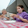 salisbury: Layla Tucker digs in during the pizza eating contest at the Sand and Sea Festival at Salisbury Beach this weekend. Jim Vaiknoras/Staff photo