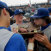 Lowell: Georgetown senior Chris Petro kisses the Div 4 North Sectional Championship trophy after his Royals defeated Trinity 9-2 at LeLacher Park in Lowell.Jim Vaiknoras/Staff photo