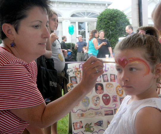 Amesbury;Artist Renee Schneider paints a rainbow and heart on eh face of Hannah Gale , 5, at the annual Amesbury Days Block Party  last night. Jim Vaiknoras/Staff photo