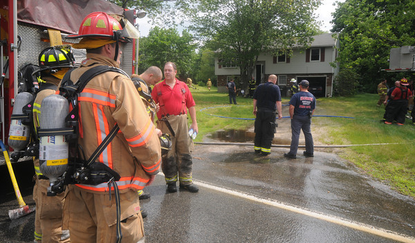 Amesbury: Firefighter at the scene of a fire on Morrill ave in Amesbury Friday morning. Jim vAiknoras/Staff photo