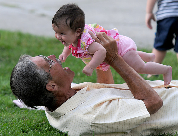 Amesbury;Alyssa Boutin, 4 months, is all smiles as she plays with her grampa Sonny Boutin at the Amesbury Days Block Party near the library last night. Jim Vaiknoras/Staff photo