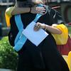 newburyport: Madison Moran hugs Dean of Student Support Services Christina Palmer at Sunday's Graduation Ceremonies at War Memorial Stadium. Jim Vaiknoras/Staff photo