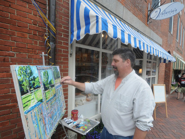 newburyport: Artist David Magdelenski paint in front of Valerie's  Gallery on State Street in Newburyport Saturday as part of the Art Walk. Jim Vaiknoras/Staff photo