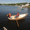Amesbury: Andy Valeri and Jenn Durrette take a ride in a dory built by a group of kids from the Greater Lawrence Education Collaborative at Lowell's Bpat Shop in Amesbury. Jim Vaiknoras/Staff photo