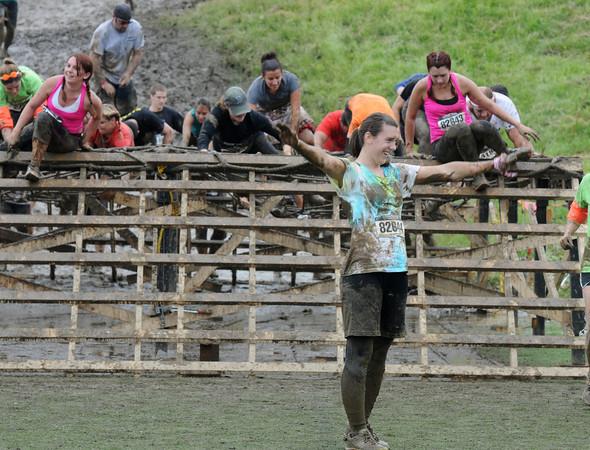 Amesbury: Laura Sadlier celebrates after finishing the Warrior Dash at Amesbury Sports Park Saturday. Jim Vaiknoras/Staff photo