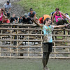 Amesbury: Laura Sadlier celebrates after finishing the Warrior Dash at Amesbury Sports Park Saturday. Jim Vaiknoras/Staff photo